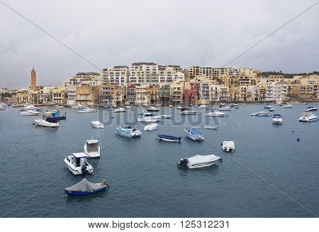 MARSASCALA, MALTA-SEP 9: typical colorful maltese village Marsascala on sep 9, 2015. Cloudy morning in Marsascala, Malta. Maltese island, Europe