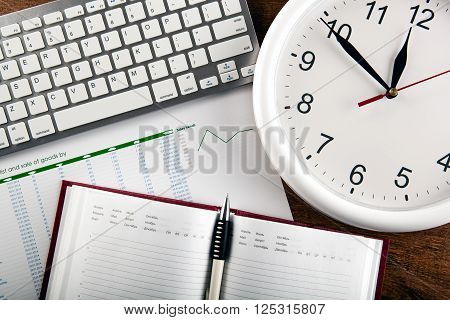 diary and office supplies and large clock