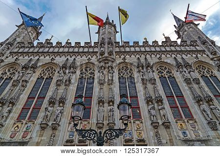 Architectural facade detail at one old building placed in Burg square Bruges Belgium.