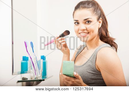 Cute Girl Putting Blush On Her Face