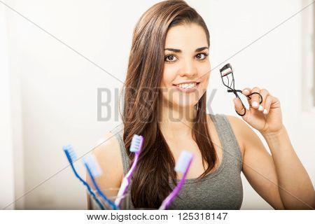 Woman Using An Eyelash Curler