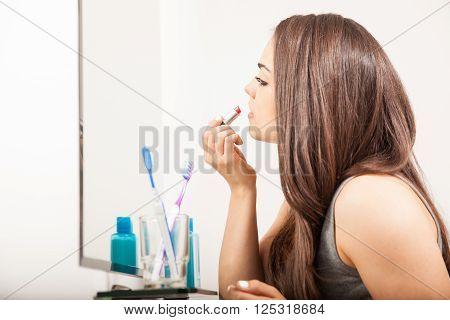 Beautiful Girl Putting Some Lipstick On