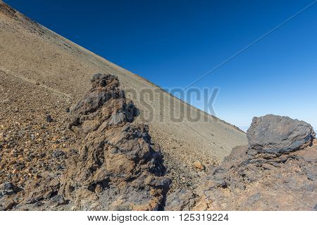 From the last station of the funicular to the crater of the volcano Teide is a narrow path, trodden by tourists.