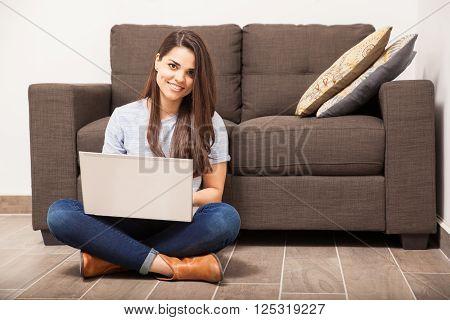 Cute Hispanic Woman Using A Laptop Computer