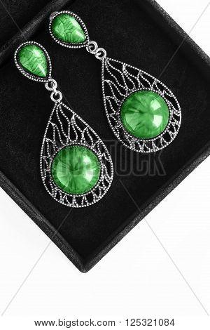 Vintage malachite earrings in black velvet box closeup