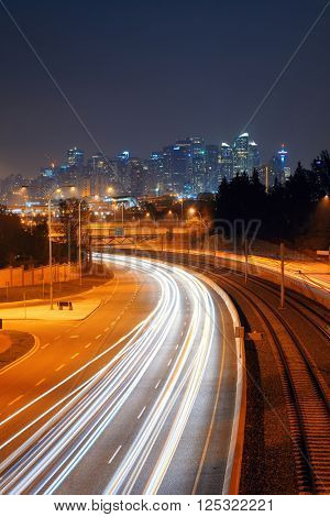 Calgary downtown with light trails at night, Canada.