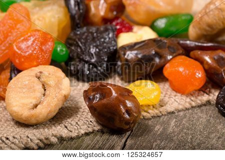 Dried fruit: apples dried apricots fig dates. Close up small depth of sharpness flat lay