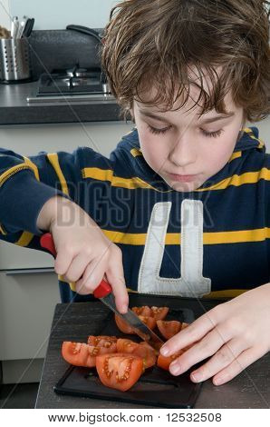 Boy Cutting Tomato