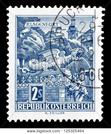 AUSTRIA - CIRCA 1968 :  Cancelled postage stamp printed by Austria, that shows Dragon Fountain in Klagenfurt.
