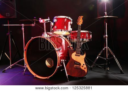 Musical instruments on a stage on dark background