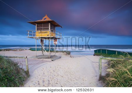 Lifeguard Hut On Australian Beach With Interesting Clouds