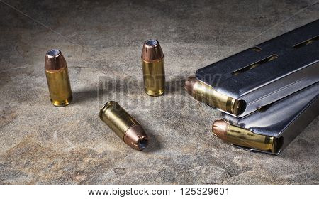 Hollow point ammunition with magazines for a semi automatic handgun