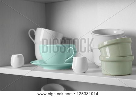 Dishes in cupboard in the kitchen