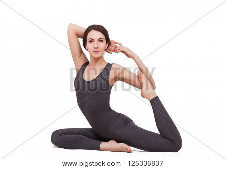 young beautiful woman doing yoga isolated on white