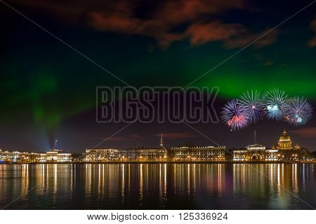 Embankment in St. Petersburg, Russia, overlooking the St Isaac's Cathedral. On the palate the northern lights and fireworks.