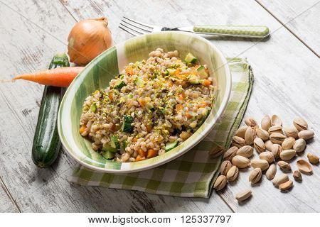 barley risotto with zucchinis carrots and pistachio nut
