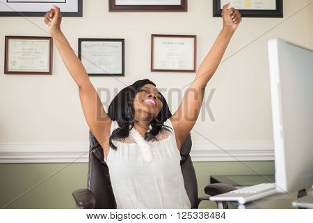 Young Successful Business Woman Celebrating in Office