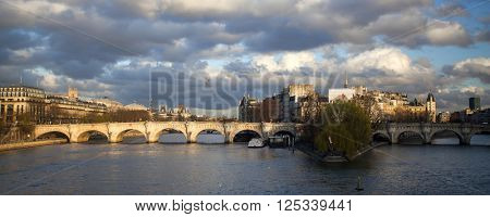 PARIS, FRANCE- MARCH 25:Pont Neuf bridge in the sunset, and stormy sky, Ile de la Cite, Paris - France