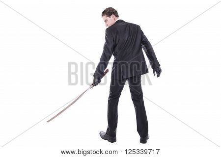 Young handsome businessman holding katana sword. Isolated on white background.
