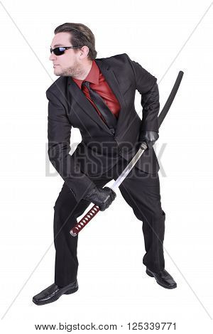 Handsome man holding katana sword. Isolated on white background. ** Note: Soft Focus at 100%, best at smaller sizes