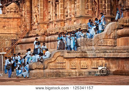 TANJORE, INDIA - MARCH 26, 2011: School children visiting famous Brihadishwarar Temple in Tanjore (Thanjavur), Tamil Nadu. It is UNESCO World Heritage Site and importang religious and cultural site