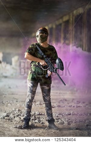 female paintball player in dramatic scene