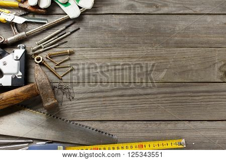 old tools on a wooden table with copy space for text