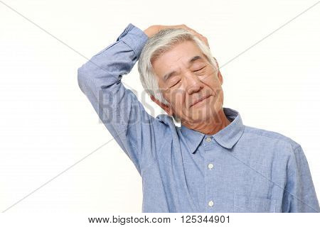 portrait of senior man doing self neck stretch