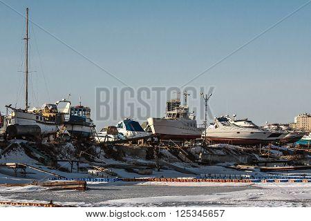 frozen sea yachts winter in the city of Vladivostok Russia
