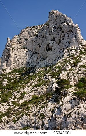 High cliffs tower over the Mediterranean Sea