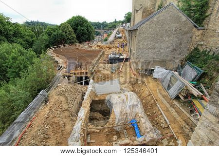 view on construction  a new road and restoration of ancient building in Luxembourg