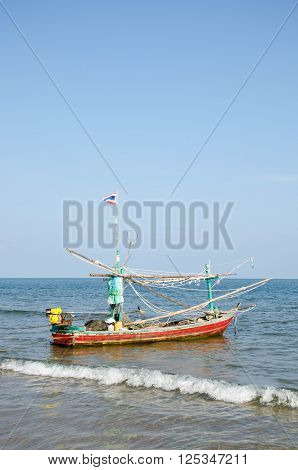 Old Wooden Local Fishing Boat On On Sea Coast And Beach With Summer