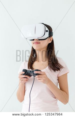 Thrilled woman play game with VR device