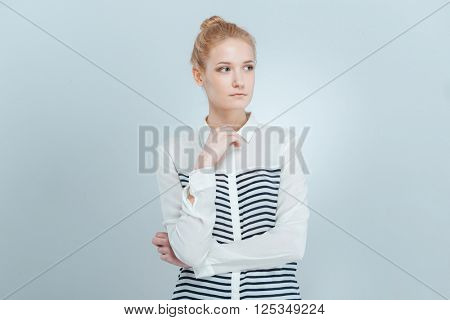 Casual blonde woman looking away isolated on a white background