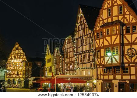 street with half-timbered houses in Limburg old town at night Germany