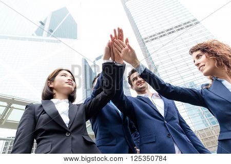 Group of business people joing hand together