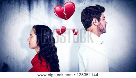 Couple standing back to back after arguing against heart