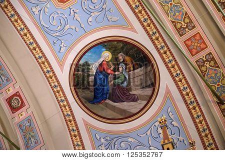 STITAR, CROATIA - AUGUST 27: Visitation of the Virgin Mary, fresco in the church of Saint Matthew in Stitar, Croatia on August 27, 2015