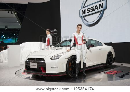 BANGKOK - MARCH 22: Nissan GTR car with Unidentified models on display at The 37 th Thailand Bangkok International Motor Show on March 22 2016 in Bangkok Thailand.