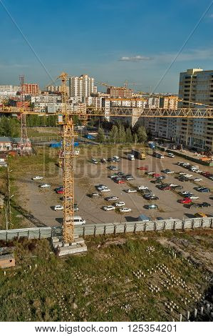 Tyumen, Russia - September 5, 2010: Construction site near Scherbakova 90 and parking lot