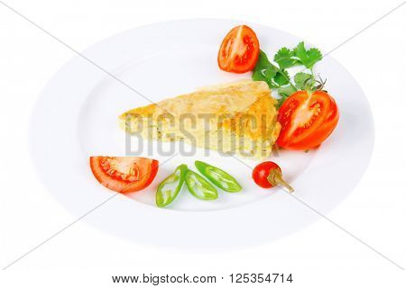 food : vegetable casserole triangle on white plate with pepper and tomatoes isolated over white background
