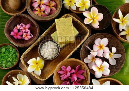 Spa setting Background with frangipani ,soap,salt in bowl