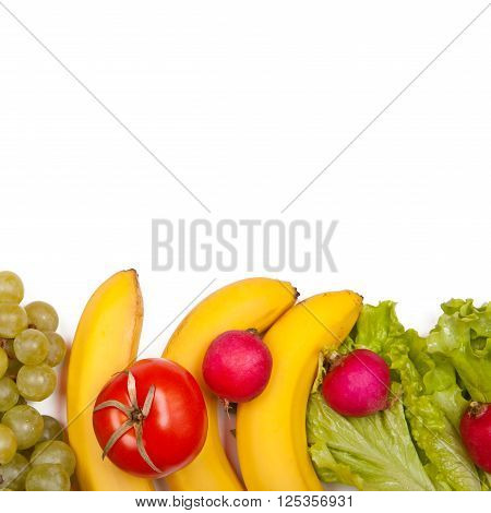 Group of juicy fruits and vegetables on a white background