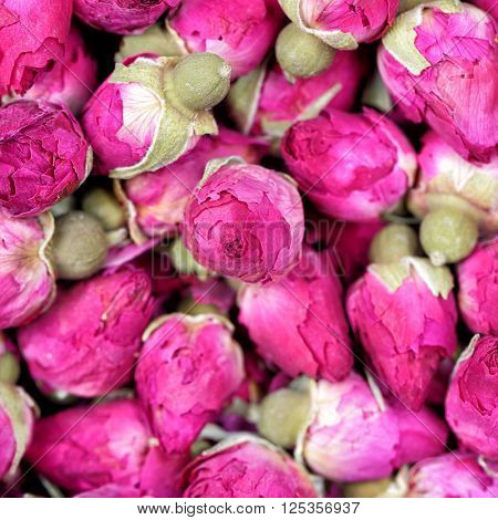 Dried rose flowers texture background closeup. Rose tea - dried rosebuds flowers texture closeup. Dry roses petals for Asian tea and spices. Copyspace for element or background.