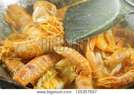 Silver Mantis Shrimp and Prawn cooked in the wok. In the middle of cooking process.