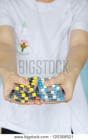 Antibiotic drugs in hands. Health care concept.