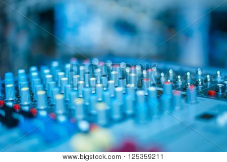 close-up view of professional sound mixer,blue toned,still life.