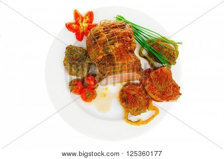 meat with chives and tomatoes over white plate