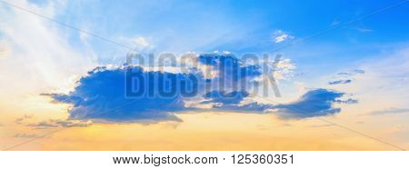 Colorful sunset sky with cumulus clouds. Beautiful bright sunset sky background.