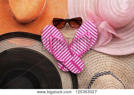 Sun hat sunglasses and flip-flops beach accessories beach fashion